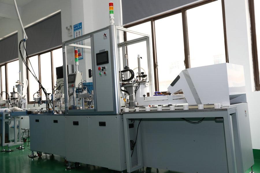 Glühlampenbestückungsmaschine 1